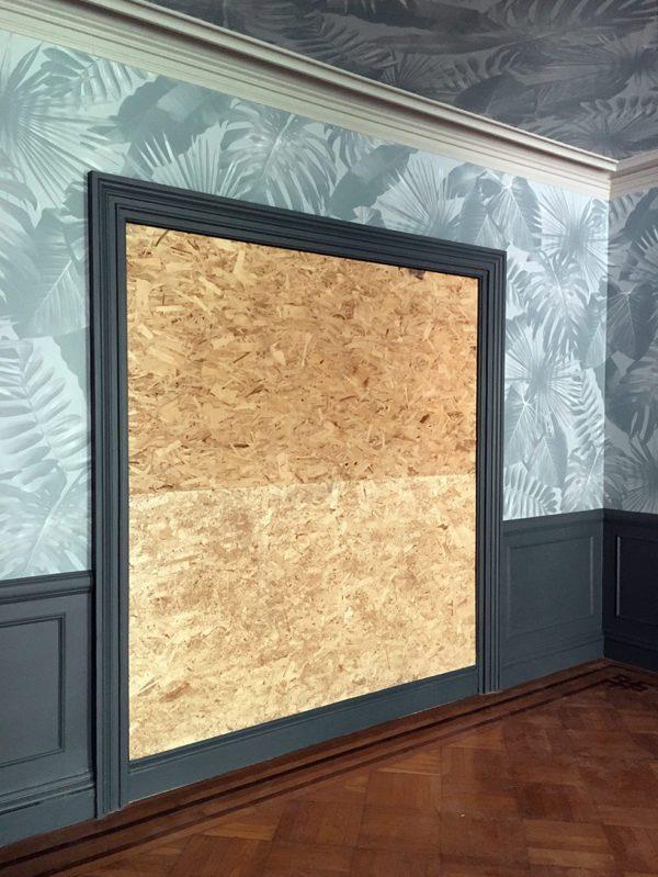 Before antique mirror panel installation